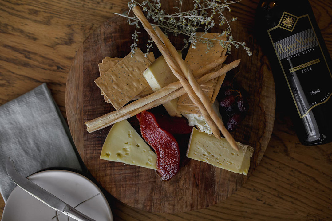 The Riverstone Estate wine bottle and charcuterie board