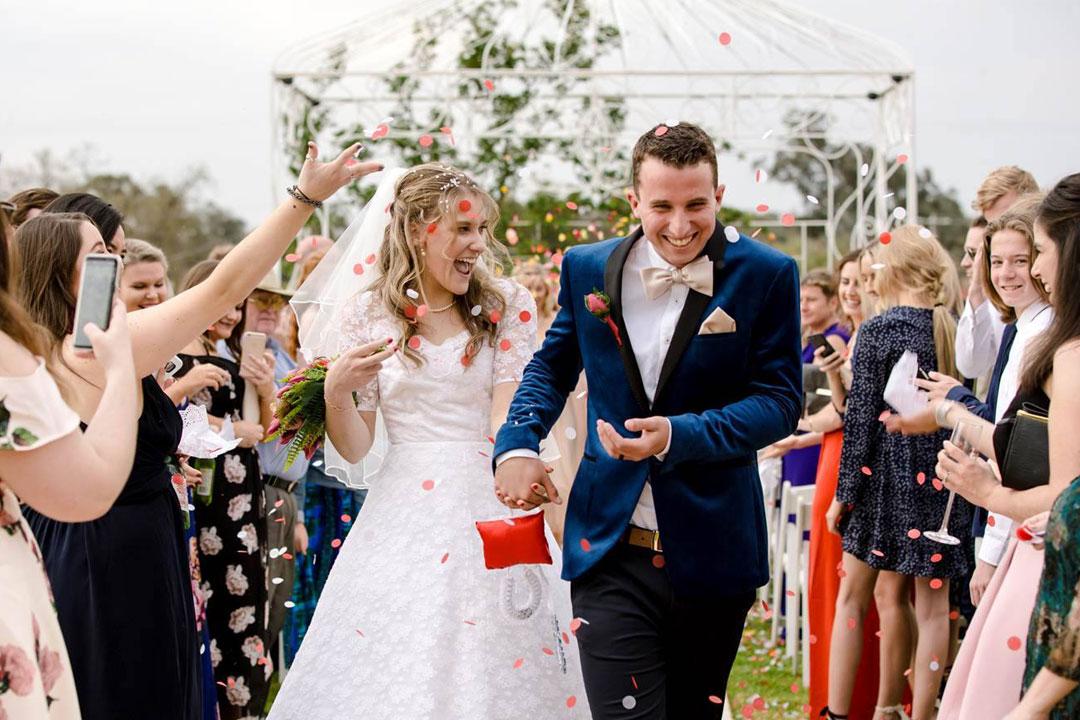 Rutherglen Estates wedding ceremony bride and groom flower petals