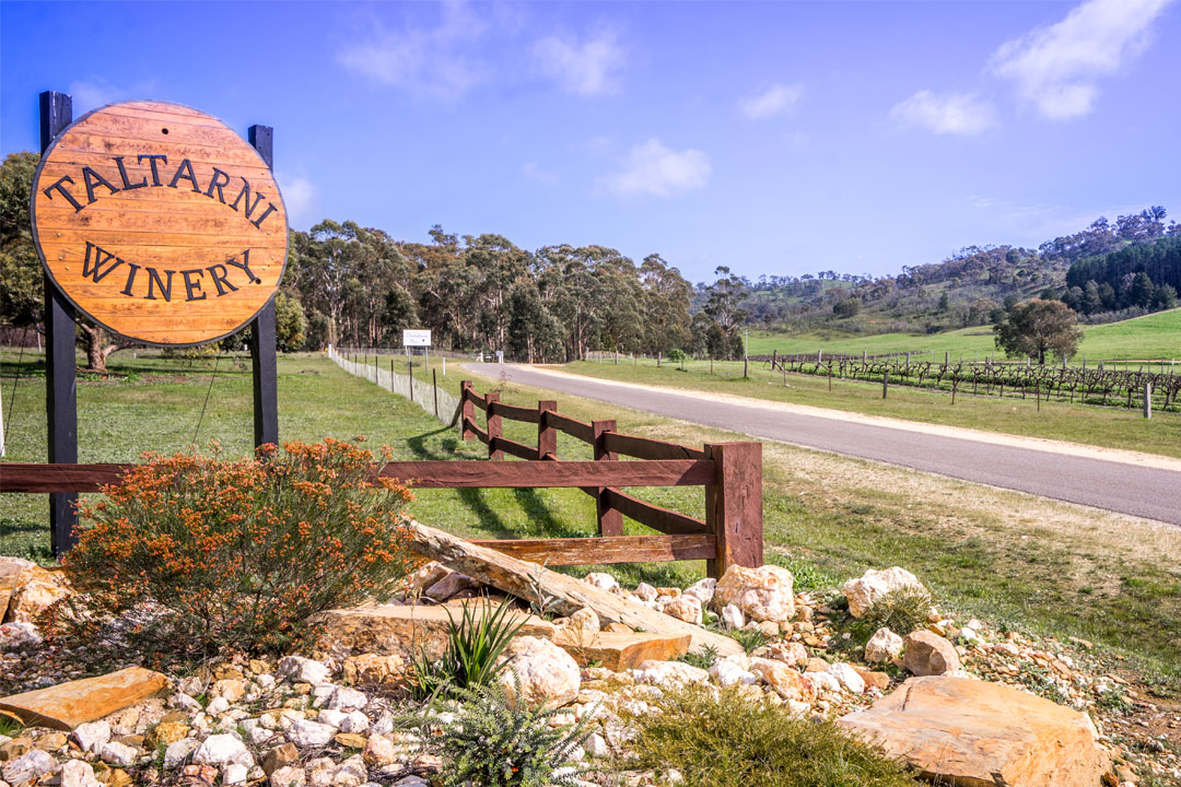 Taltarni Vineyards welcome sign road and fence